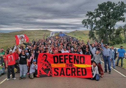 Native Americans march to a burial-ground sacred site that was disturbed by bulldozers building the Dakota Access Pipeline near Cannon Ball, N.D. BECK/AFP/GETTY IMAGES