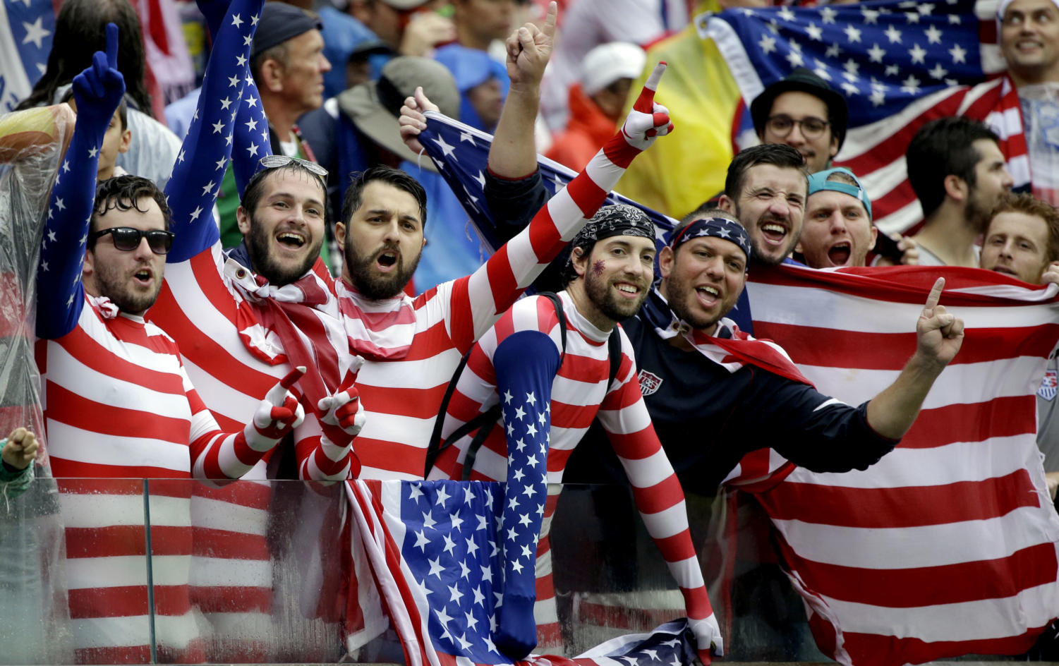 USA supporters cheer for their national team during the group G World Cup soccer match between the USA and Germany at the Arena Pernambuco in Recife, Brazil, Thursday, June 26, 2014. (AP Photo/Ricardo Mazalan) ORG XMIT: WCDP144