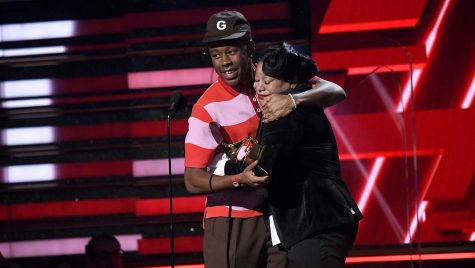 LOS ANGELES, CALIFORNIA - JANUARY 26: (L-R) Tyler, the Creator and his mother accept the Best Rap Album award for